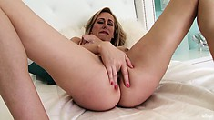 Busty MILF Brett fingers that twat and licks her fingers it taste so good