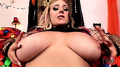 Busty blonde babe Sapphire in fishnet lingerie playing with her big melons
