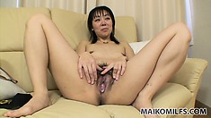 Taking her clothes off, she reveals her lovely tits, nice ass and tight hairy pussy