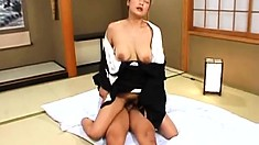Driven by excitement and desire, the Oriental milf jumps on top and rides his dick
