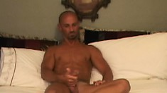 Bald dude with great muscles strokes his meat while getting fucked