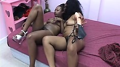With their fingers and a strap-on dildo, these ebony lesbians fulfill their desires