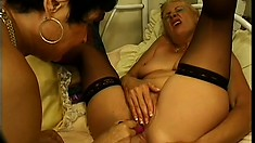 Two horny mature lesbians in sexy lingerie drill their hungry holes with sex toys