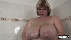 Chunky woman relieves herself by massaging her private parts under the shower