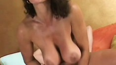 Delightful cougar opens her pussy wide for excited young stud
