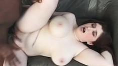 Chunky redhead babe with a stunning rack sucks on a big black boner