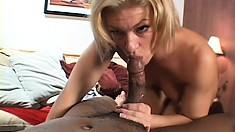 Gorgeous white hooker gives a big black cock a great massage