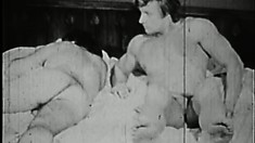 Submissive young guy takes every inch down his throat in vintage video